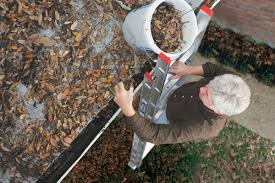 Man Cleaning Gutters, Gutterco - Columbus Ohio Gutters